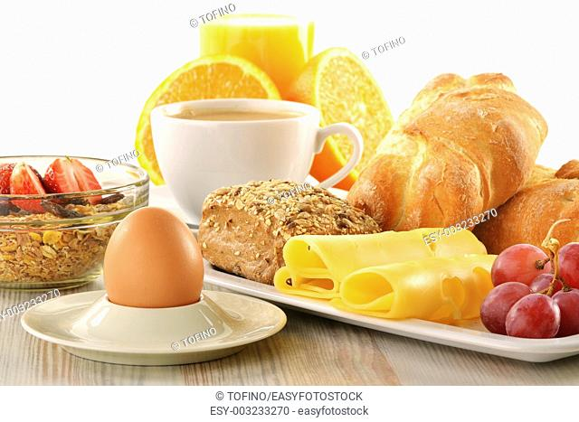 Breakfast with coffee, rolls, egg, orange juice, muesli and cheese