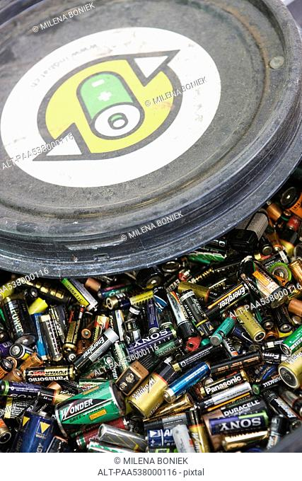 Batteries in recycling bin