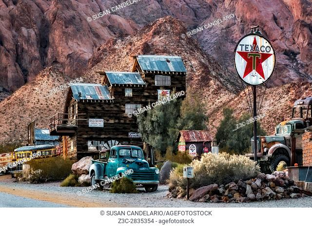Vintage Texaco Gas Station - Ghost town vintage Texaco Gasoline Station along with a wooden inn and old rusted cars, trucks and buses