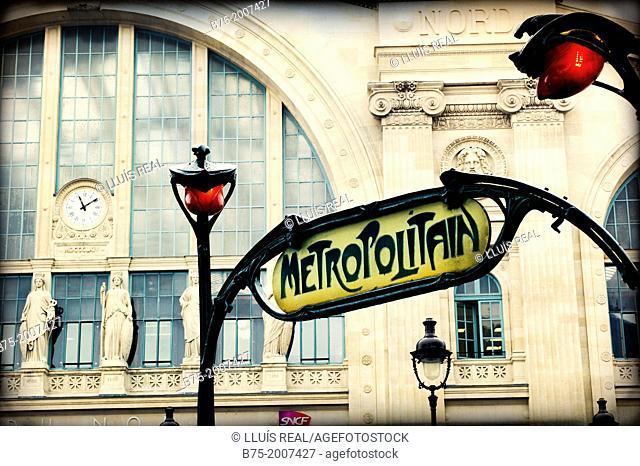 Partial view of the main facade of the Gare du nord and Art Deco entrance of the Metropolitan, Paris, France, Europe