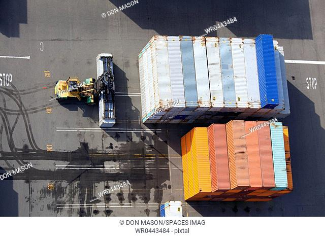 Containers Moved by a Mast Forklift