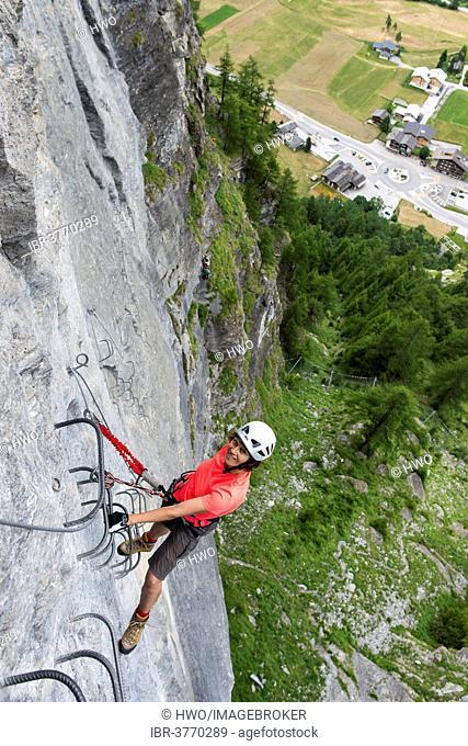 Female climber on the fixed rope route Via ferrata d'Evolene Region, Evolène, Canton of Valais, Switzerland