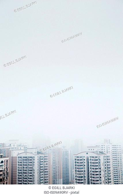 High angle view of mist over skyscrapers, Shanghai, China