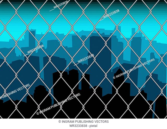 City scape skyline behind a metal fence with blue sky