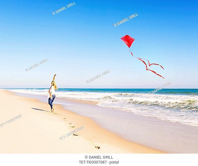 Woman on beach with kite