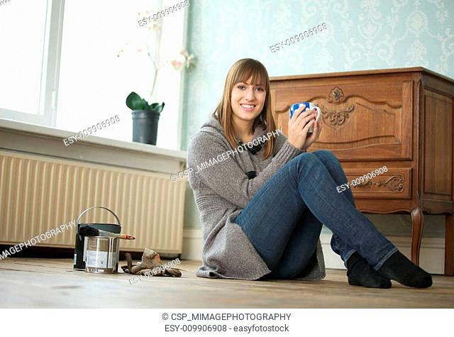 Young Woman Holding Tea Cup