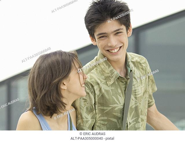 Young man and young woman laughing