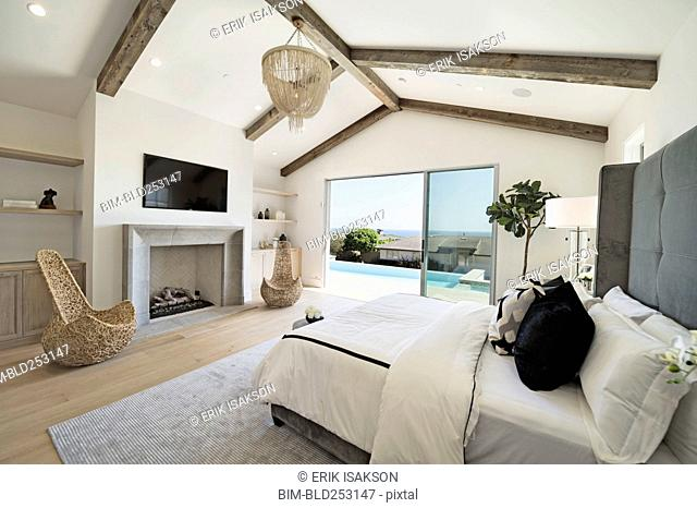 Bed and fireplace in luxury bedroom