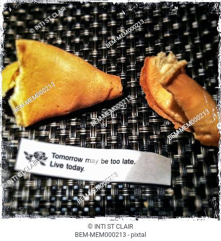 Open fortune cookie with fortune