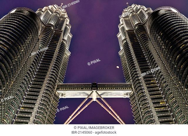 Petronas Towers at night with moon, skybridge, Kuala Lumpur, Malaysia, Southeast Asia
