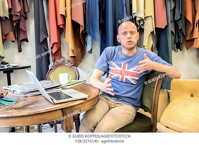 Tilburg, Netherlands. Werner is the male partner of apprentice upholsterer Josef. On saturday's he helps out in the workshop