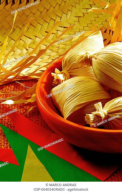 pamonha food dish with a straw hat for june celebration