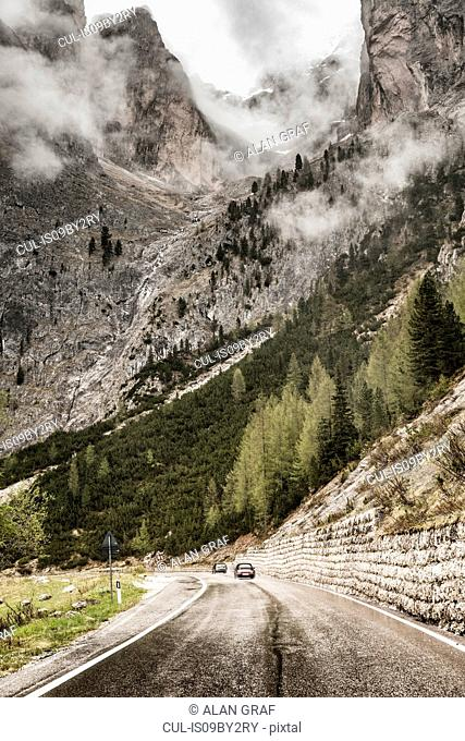 Landscape with mountain valley road and low cloud, Sankt Ulrich am Pillersee, Tyrol, Austria