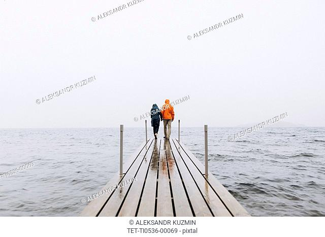 Couple on pier in Iceland