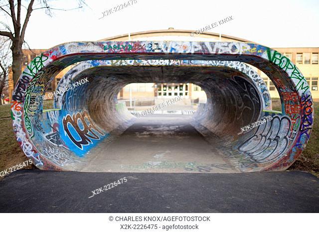 Concrete full pipe mini ramp for skateboarding, montreal, quebec, canada