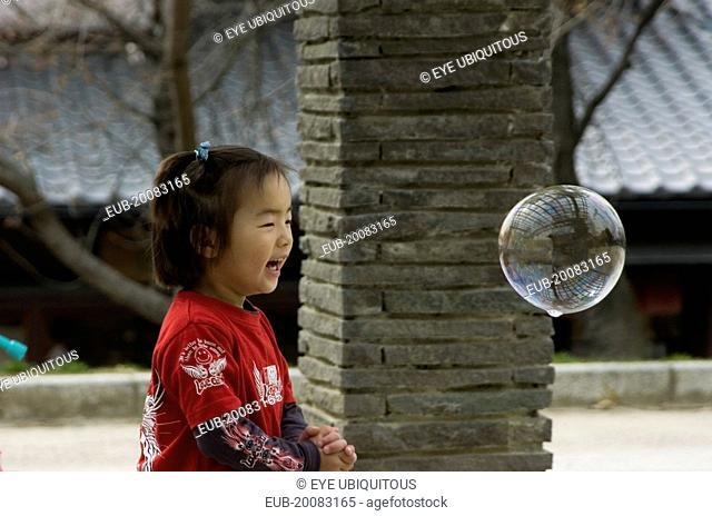 Child playing with bubbles near Maruyama-koen Park