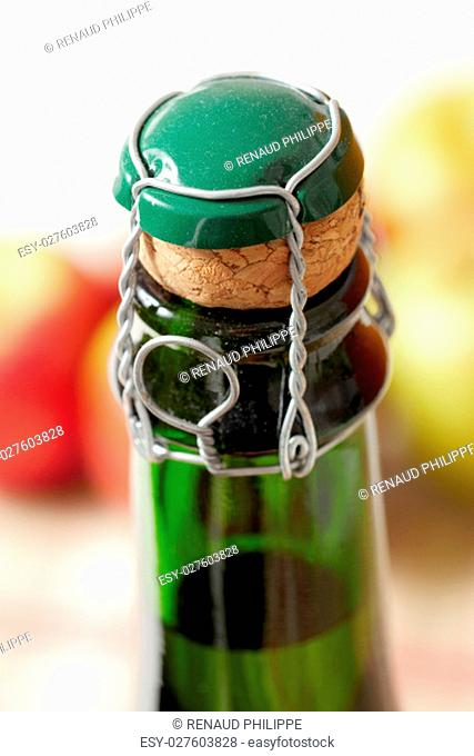 Close-up of the cork of a cider bottle