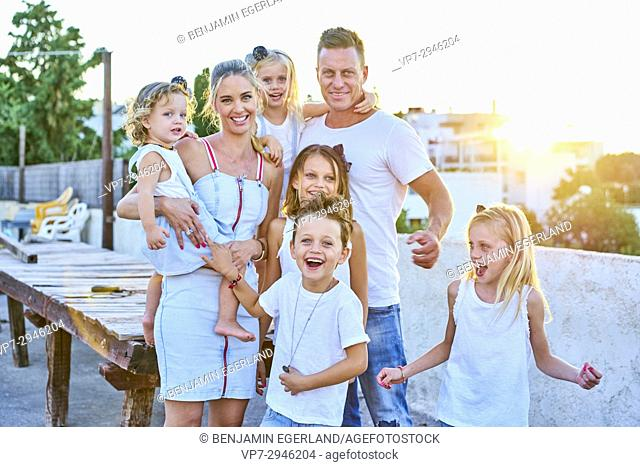 happy family during sunset. Australian ethnicity. During holiday stay in Hersonissos, Crete, Greece