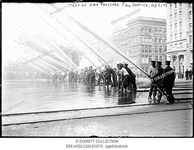 Fireman testing high-pressure hoses, New York City New York, 1900-1910