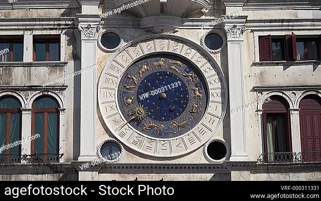 Pan up of the Astrological Clock, St Marks Square, Venice, Italy