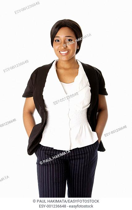 Beautiful attractive smiling corporate business woman standing with hands in pocket, isolated