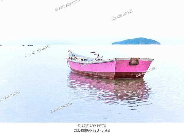Anchored pink rowing boat, Manguinhos, Buzios, Rio de Janeiro, Brazil