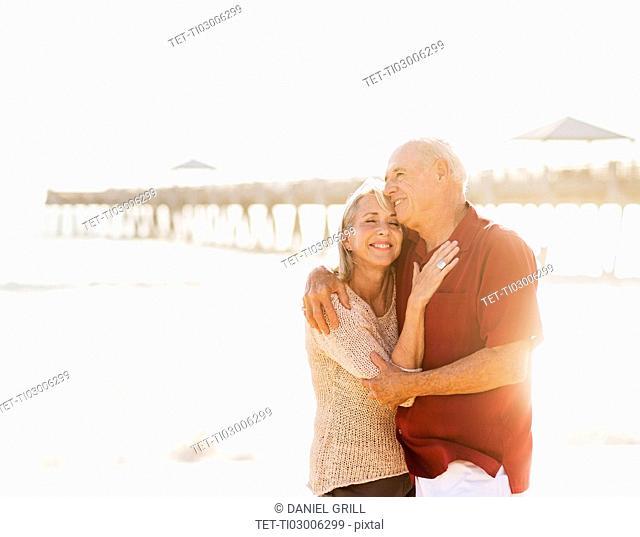 Senior couple embracing on beach