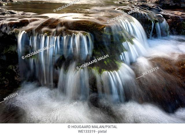 Landscape photo of a waterfall on a sunny day. Pondoland, Eastern Cape, South Africa
