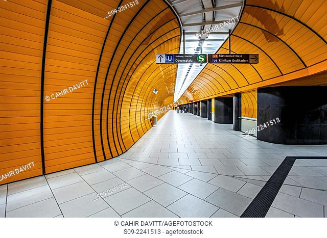 Yellow ceramic tiling and black stone finish leading to the platform of the Odeanspaltz U-Bahn station in Altstadt - Lehel, Munich, Bavaria, Germany
