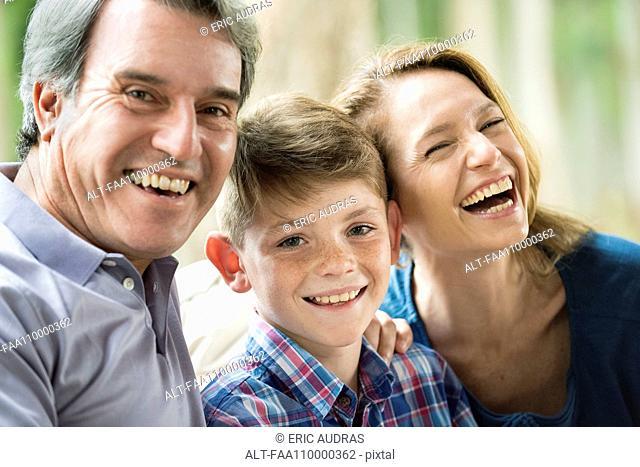 Family smiling together, portrait