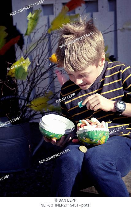 Boy with Easter egg full of sweets