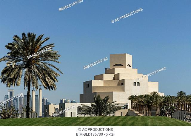 Doha Museum of Islamic Art under blue sky, Doha, Qatar