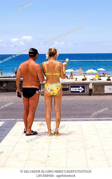 Couple at beach. Canary Islands. Spain