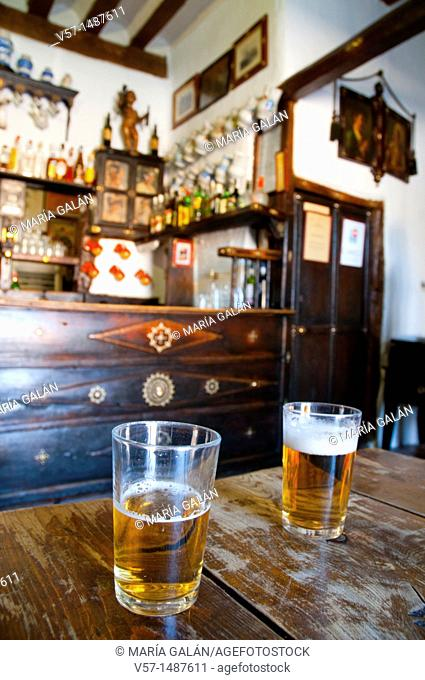 Two glasses of beer in a typical tavern. Pedraza, Segovia province, Castilla León, Spain