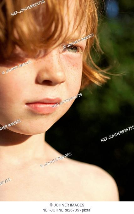 Portrait of a redheaded boy, Sweden