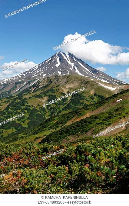 Beautiful mountain landscape on Kamchatka Peninsula: picturesque view of Vilyuchinsky Volcano at sunny day. Photo stratovolcano photographed with Vilyuchinsky...