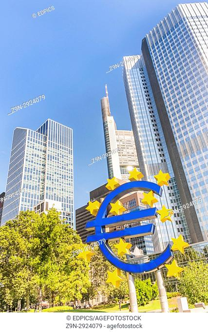 euro symbol in front of eurotower european central bank building in frankfurts central business district, frankfurt am main, hesse, germany