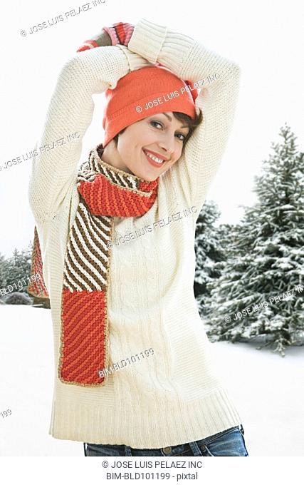 Caucasian woman standing in snow