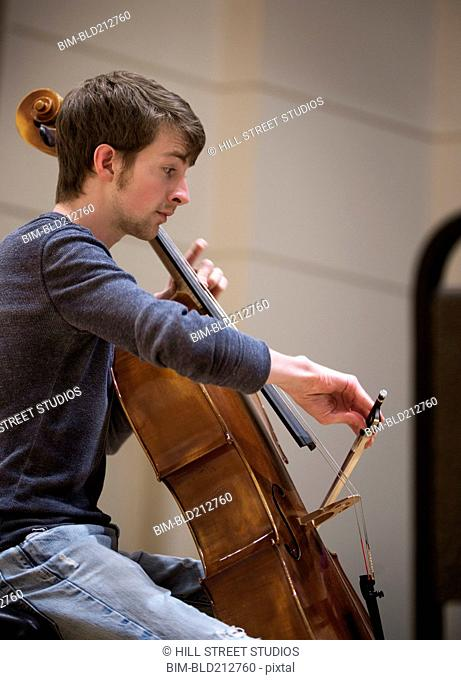 Caucasian student playing cello