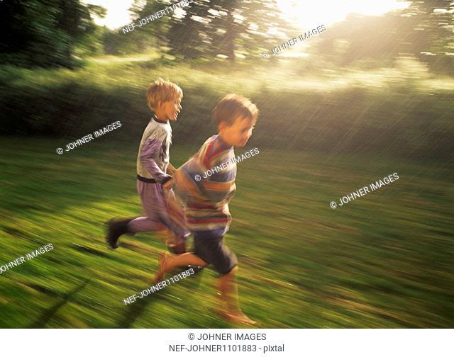 Boys running in rain