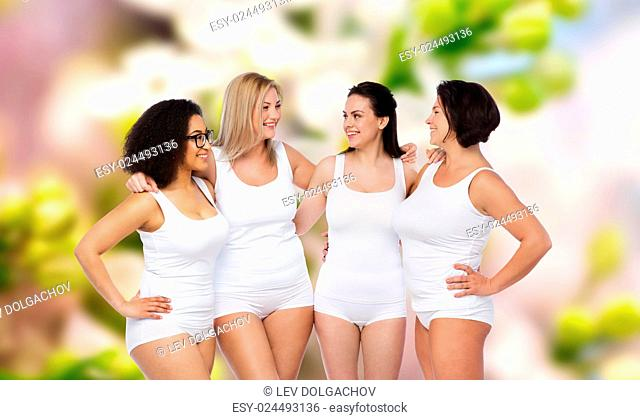 friendship, beauty, body positive and people concept - group of happy women different in white underwear over natural spring background