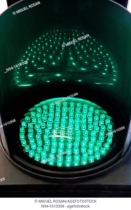 Traffic light of leds green illuminated at night that gives continuing