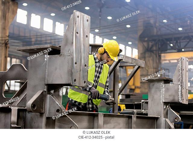 Steel worker working in fabrication factory