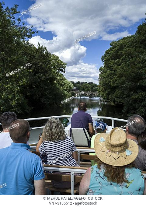People on a river cruise boat on the river Avon by Bathampton, Bath, Somerset, England, UK