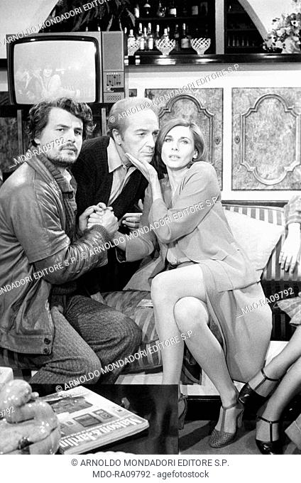 Italian actors Michele Placido, Rossano Brazzi e Paola Pitagora (Paola Gargaloni) on the set of a TV show. 1974