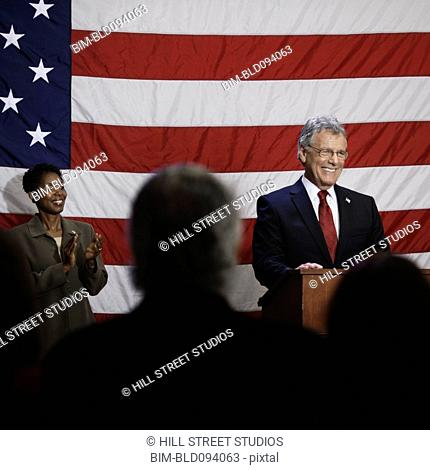Caucasian politician making speech at podium