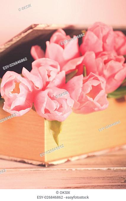 Shabby chic decoration - pink tulips in vintage book