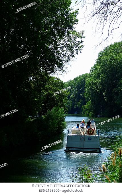 Piloting a rental boat down the Canal du Midi by Agde, France