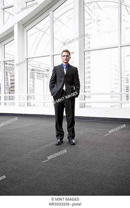 Portrait of a Caucasian businessman at a convention centre space