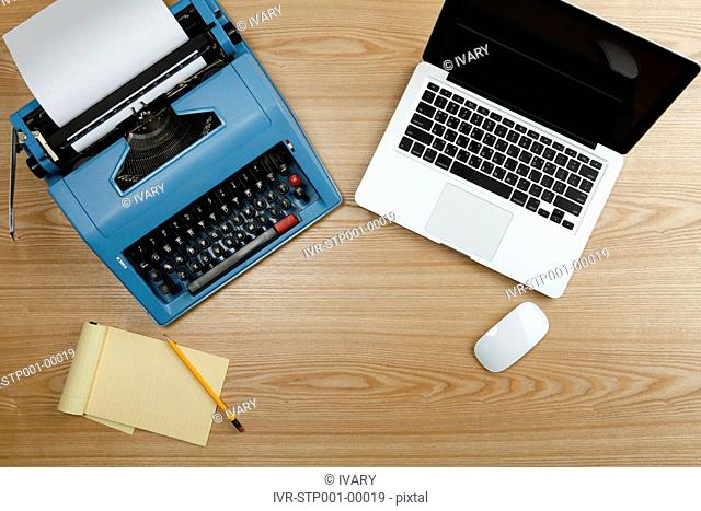 High Angle View Of The Typewriter And Laptop